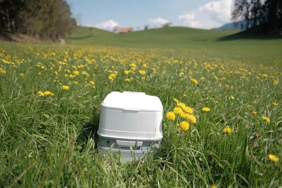 Portable Toilet for Van Camping in a Field