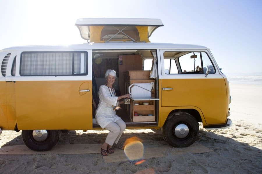 Woman Making Coffee Inside a Camper Van