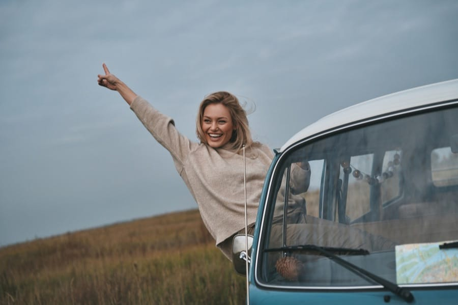 Woman Leaning Out of Window Van Camping