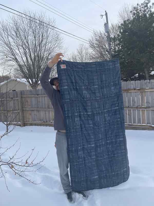 Holding up the Kelty Bestie Blanket
