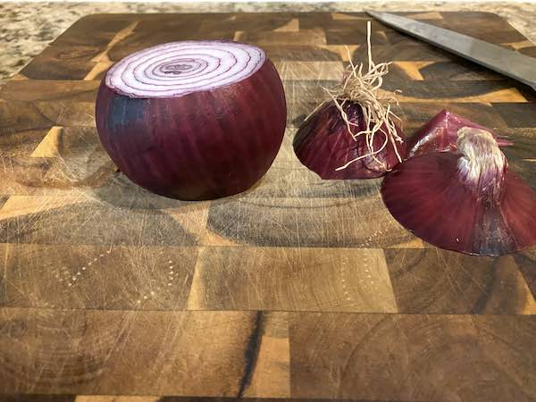 Cutting both ends off the onion.