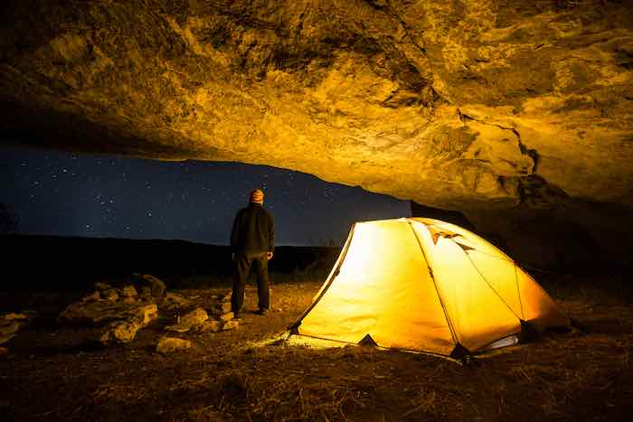 Glowing tent at night.