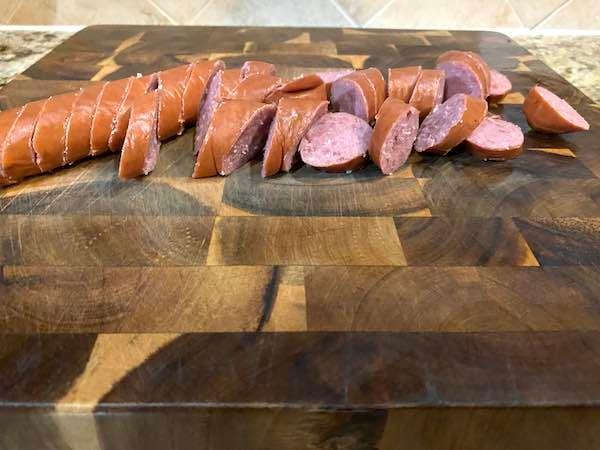 Prepared sliced smoked sausage.