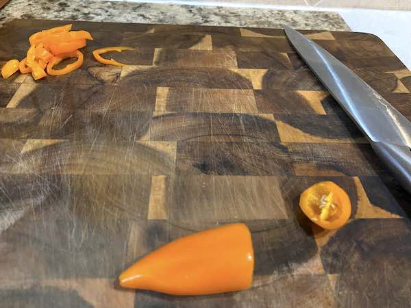 Slicing the sweet peppers. Be sure to remove the ribs and seeds.