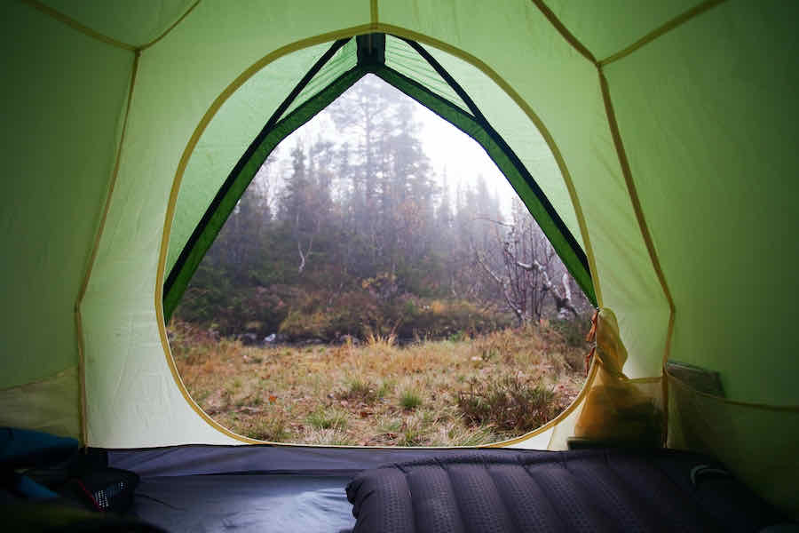 Looking out of a tent into the rain