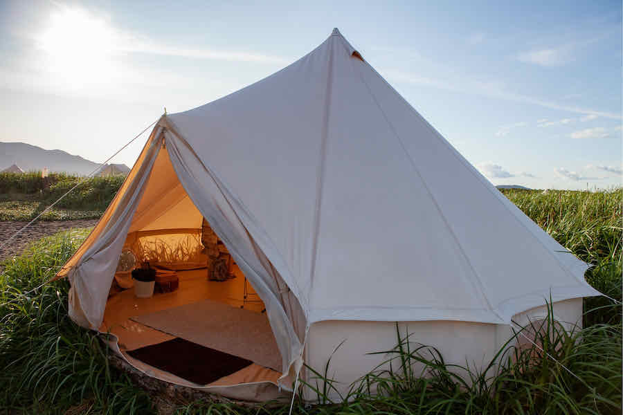 canvas yurt tent glamping in a field