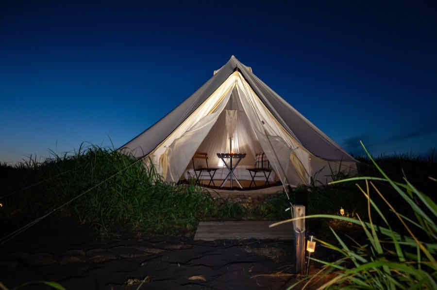 canvas glamping yurt tent at night